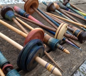 Spindles lined up. Chac-Chacs, Tibetans, Russian, Drop Spindles