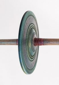 Close up of a hand dyed Akha spindle whorl